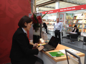 Kate Edwards represents the Associate of Canadian Publishers at the Frankfurt Book Fair 2013, with the Kids Can Press booth across the street. © Catherine Mitchell
