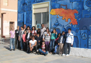 Local students gather outside the library in Lampedusa, Italy. Photo courtesy of Mariella Bertelli