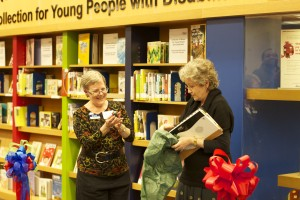 Leigh Turina (left) and Heidi Boiesen (right) exchange gifts after the ceremonial ribbon cutting. Photo: Camilia Kahrizi