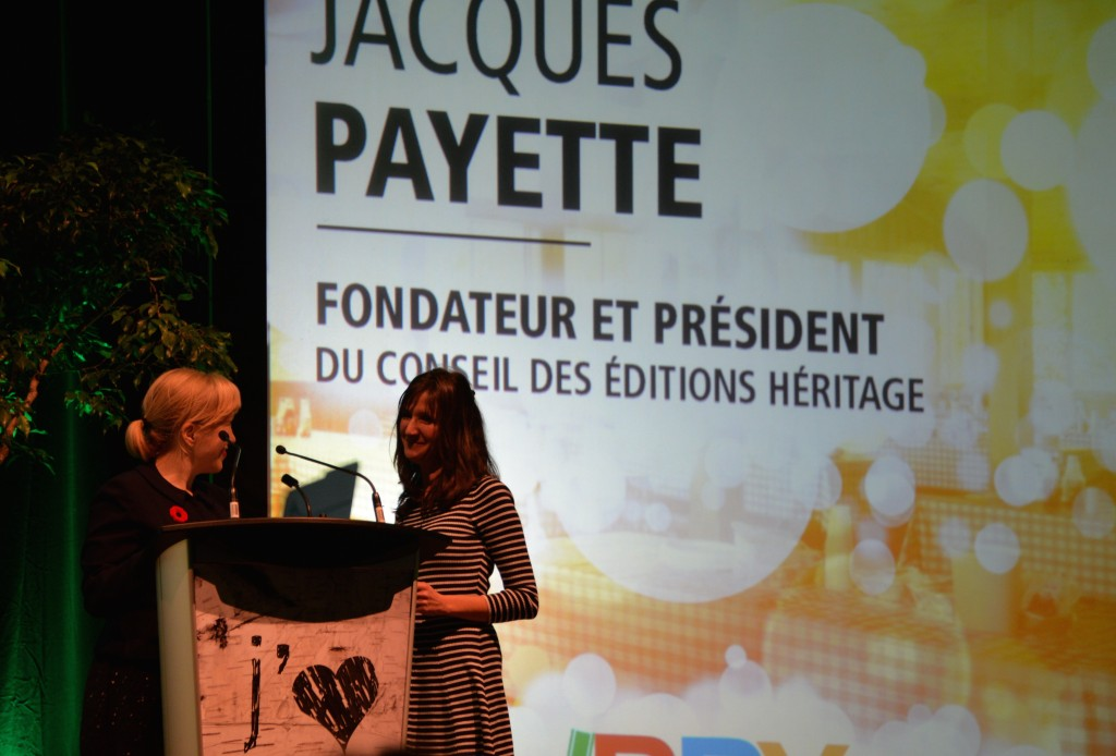 IBBY Canada President Shannon Babcock (left) presents the 2014 Claude Aubry Award at the Prix TD in Montreal. Accepting the award for Jaques Payette is Agnès Huguet (right), editorial director of Dominique et compagnie. Photo courtesy of Danièle Courchesne.