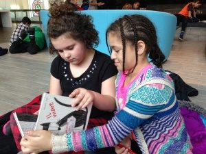 "Grade 3 students Autumn and Eujenaé reading Il Mare (""The Sea"") (Officina Libraria, 2012) at the Hamilton Wentworth District School Board Education Centre"