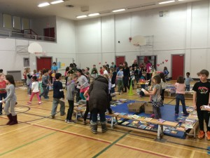 Students of Edmonton's Westglen School participate in a second-hand book fundraiser for Lampedusa. Photo courtesy of Cory MacTaggart