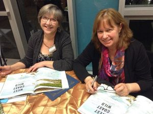 Author Deborah Hodge (right) and illustrator Karen Reczuch (left) sign copies of their award-winning book, West Coast Wild: A Nature Alphabet (Groundwood Books, 2016). Photo courtesy of Lee Edward Födi.
