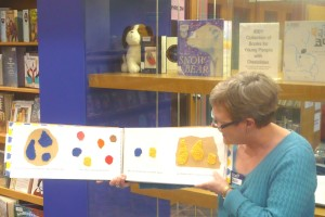 Leigh Turina of the Toronto Public Library displays a Braille edition of Leo Lionni's Little Blue and Little Yellow (Les doigts qui rêvent, 2007) at the IBBY Collection of Books for Young People with Disabilities, North York Central Library, Toronto. Photo courtesy of Toronto Public Library