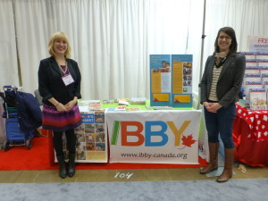 Shannon Babcock (left) and Yvette Ghione (right) at the IBBY Canada booth during INSPIRE! Toronto International Book Fair. Photo courtesy of Liz Page.
