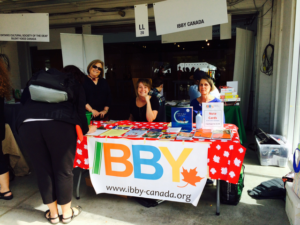 IBBY Canada volunteers at Toronto's The Word On The Street on September 25, 2016. From left to right: Lesley Clement, Katie Scott, Grace Andrews. Photo courtesy of Theo Heras.